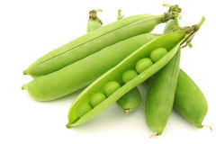 Opened green pea pods with peas visible Royalty Free Stock Images
