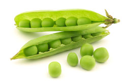 Opened green pea pods with peas visible Stock Image