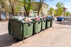 Opened green plastic recycling containers with garbage Royalty Free Stock Image