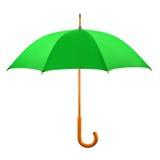Opened green umbrella. Isolated on white background Royalty Free Stock Images