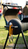 Opened grill. Opened charcoal grill oven with grilling tool hanging from the handle Royalty Free Stock Images