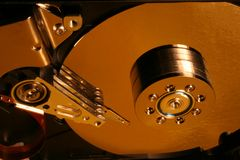 Opened hard disk details. Opened hard disc in yelow stock photography