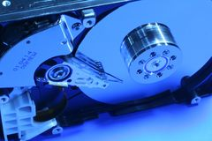 Opened hard disk details. Opened hard disc in blue stock photos
