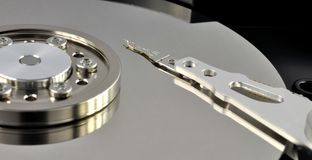 Opened hard disk drive. Close up of opened hard disk drive, data saving concept Royalty Free Stock Photo