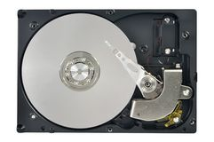 Opened hard disk drive. Close up of opened hard disk drive, data saving concept Royalty Free Stock Photography