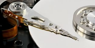 Opened hard disk drive. Close up of opened hard disk drive, data saving concept Stock Photo