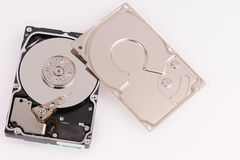 Opened  hard disk drive. On grey background Royalty Free Stock Image