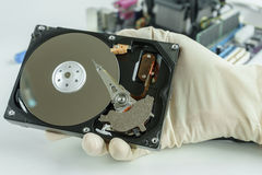 Opened hard disk drive in hand. Ready to repair and recovery data storage Royalty Free Stock Images