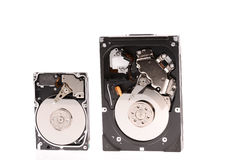 Opened hard disk drive isolated on white. Background Royalty Free Stock Images