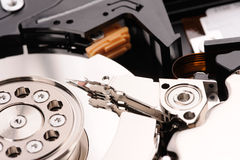Opened hard disk drive isolated on white. Background Stock Photos