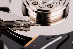 Opened hard disk drive isolated on white. Background Royalty Free Stock Photo