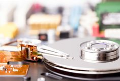 Opened hard disk drive. With main board on backstage Stock Image