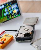 Opened hard disk drive in service. Data recovery concept Stock Images