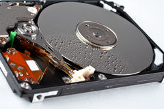 Opened hard disk drive, with water drops. Close-up of the opened hard disk drive, with water drops Royalty Free Stock Photography