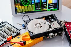 Opened hard disk in service laboratory. Data recovery concept Stock Photography