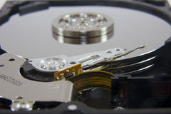 Opened hard drive. An opened hard drive showing the reading mechanism and the cylinders royalty free stock photos