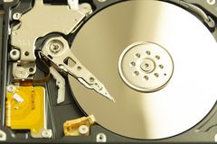 Opened hard drive. With needle on disk Royalty Free Stock Photography