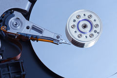 An opened a hard drive, shot close-up. Internal structure of a hard disk for PCs. Close-up pictures. The picture shows the surface of the hard disk read / write Royalty Free Stock Images