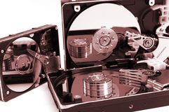 Opened hard drives. Mirrored in plates, isolated on white background, braun version Royalty Free Stock Photography