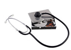 Opened harddisk with stethoscope Royalty Free Stock Photography