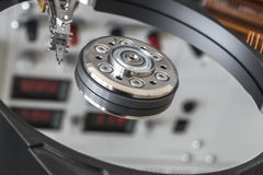 Opened HDD disc drive and reflection of laboratory panel. For testing PC components Stock Images