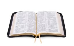Opened Holy Bible book. Isolated and placed on white stock photography