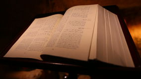 An opened Holy bible inside Our Lady of Mantara shrine, dolly shot stock video footage