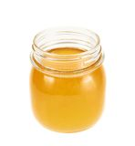 Opened honey jar isolated Royalty Free Stock Photos