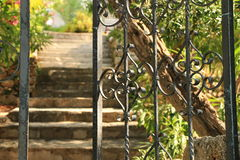 Opened iron fence and stairs in the backyard Stock Images