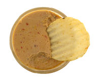 Opened jar of hummus dip with a potato chip Royalty Free Stock Photo