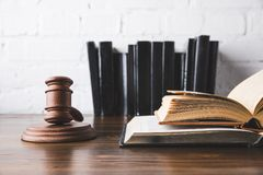 Opened juridical books with gavel on wooden table,. Law concept royalty free stock photos