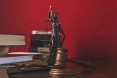 Opened juridical books with lady justice statue and gavel on wooden table,. Law concept royalty free stock photos