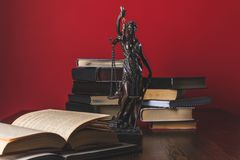 Opened juridical books with lady justice statue on wooden table,. Law concept stock images