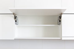 Opened kitchen cabinet Royalty Free Stock Images