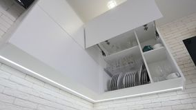Opened kitchen drawer with plates inside, a smart solution for kitchen storage and organizing stock video