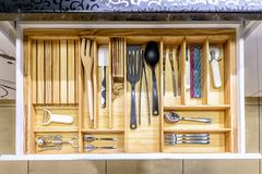 Opened kitchen drawer , a smart solution for kitchen storage and organizing.  royalty free stock image