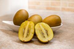 Opened kiwi fruit Stock Photos