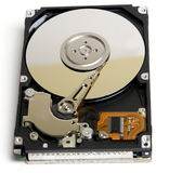 Opened Laptop Hard Drive. Opened 2.5 inch laptop/notebook hard drive. Isolated against white background royalty free stock image