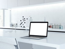 Opened laptop on a laboratory desk. 3d rendering Stock Photos