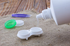 The opened lens container filled with saline for contact lenses Stock Image
