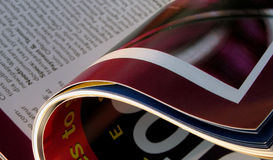 Opened magazine. Close-up image of an opened photo magazine Stock Photography