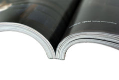 Opened magazine close-up on white background. Royalty Free Stock Photos