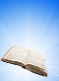 Opened magic book with light. (sky background Royalty Free Stock Images