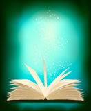 Opened magic book with magic light. Royalty Free Stock Photography