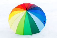 Opened multicolored umbrella. On  white background Royalty Free Stock Photo