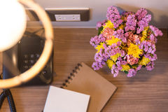 Opened Night Table with Hat, Telephone, Flower and Sketchbook Royalty Free Stock Photo