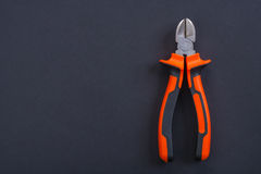 Opened nippers with orange handles copyspace Stock Photo