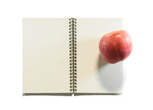 Opened note book with apple Stock Photo