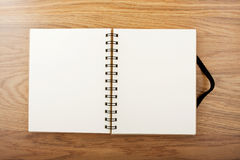 Opened notebook with black elastic band a table. Stock Image