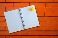Opened notebook with duck on Brick texture. Background royalty free stock image